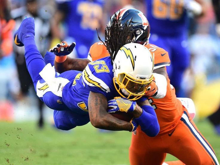 Broncos vs. Chargers:   October 13, 2016  -  21-13, Chargers   -     Dexter McCluster #33 of the San Diego Chargers dives with the ball as he is tackle by Brandon Marshall #54 of the Denver Broncos during the first quarter at Qualcomm Stadium on Oct. 13, 2016 in San Diego.