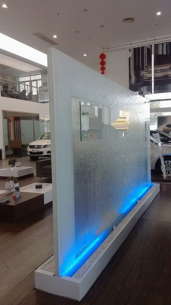 Glass Floor Standing Partition Wall Fountain. Tempered Glass. Double Sided. 12 foot long, 6.5 feet high. http://waterfallnow.com https://waterfalldecor.com