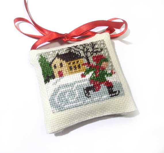 A miniature pillow ornament showing a wintry Christmas scene. An intricate embroidered picture.  Very cute ornament, great gift for Christmas or just any occasion. Suitable for Christmas tree decoration with a traditional feel. It will make your Christmas tree unique and unlike any others!  This ornament is also suitable for children - it is completely safe and does not contain any pins, beads or potentially harmful materials. Stitched on 18 count aida fabric with 3 strands of DMC threads…