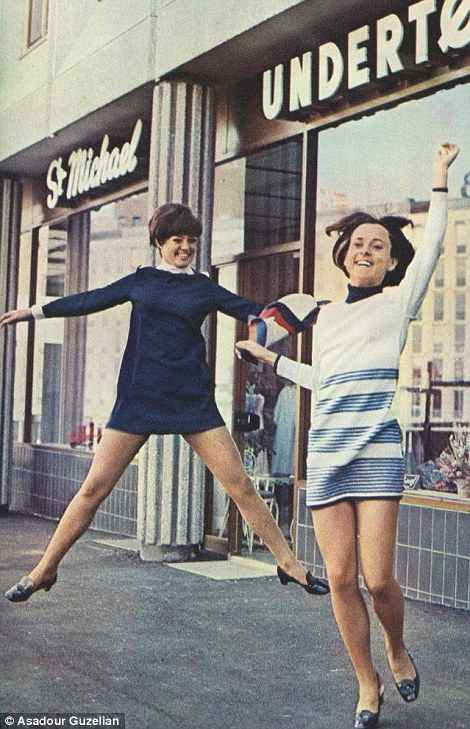 1969: Two women jump for joy outside a branch of St Michael - now Marks and Spencer.
