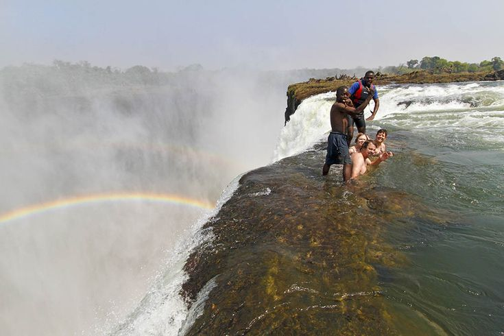 Holy hell!  Devil's Pool at Victoria Falls in Zambia.  Jump into a pool and swim up to a rock wall to lean over the edge of a 300 foot dropping waterfall!  I watched a video of people jumping in and I was nauseous, sweating, and TERRIFIED!  I might not be able to do this one!