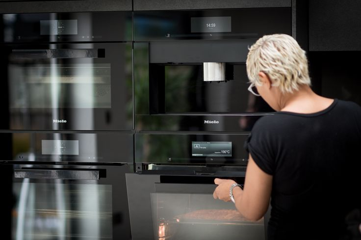 Professional chef Monica Galetti's bank of Obsidian Black Miele appliances give a glossy and professional feel