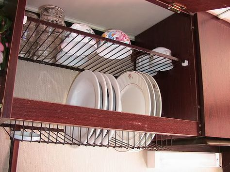 Tiskikaappi - Finnish dish rack for drying dishes inside the kitchen cabinet. Water drips down to the sink.