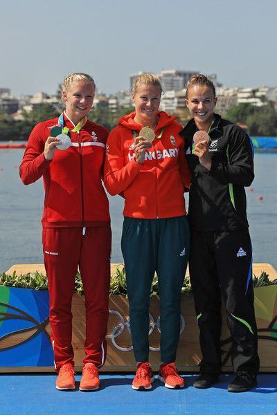 Silver medalist Emma Jorgensen of Denmark, gold medalist Danuta Kozak of Hungary and Lisa Carrington of New Zealand stand on the podium during the medal ceremony for the Women's Kayak Single 500m event at the Lagoa Stadium on Day 13 of the 2016 Rio Olympic Games on August 18, 2016 in Rio de Janeiro, Brazil.