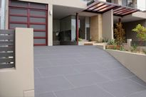 Large tile driveway resurfaced. Spraycraft concrete resurfacing, French grey hand taped