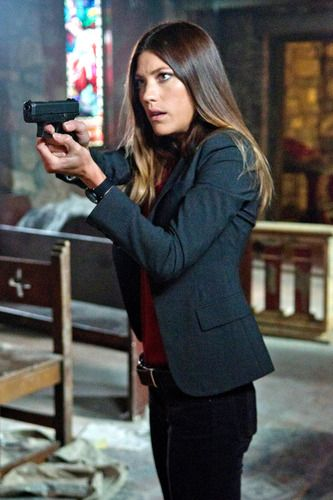 Jennifer Carpenter as Deb Morgan in Dexter--carries a gun, in love with brother... it's a long story.....