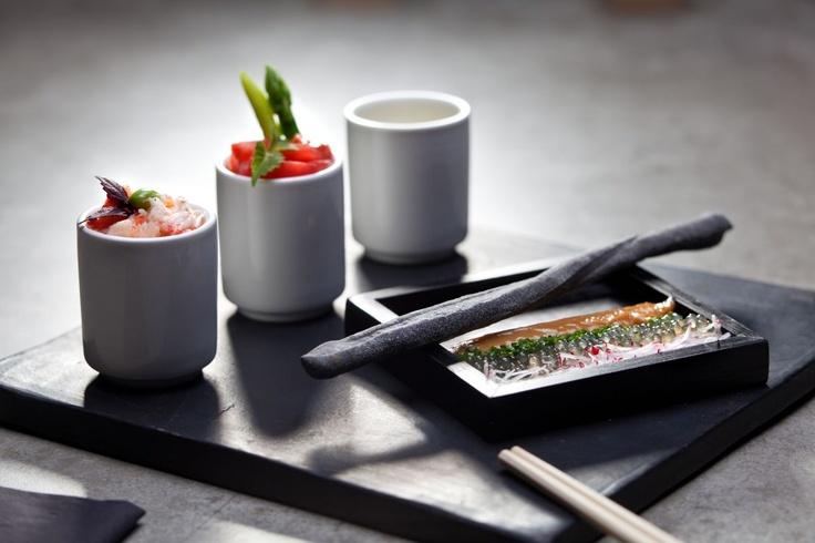 Kani Sambaizu  Traditional Japanese bento box with delicate brown crab, cherry tomatoes in Sambai Zu sauce with liquid smoke and Genmaicha, accompanied by tapioca pearls, chive and red radish with dark miso mayonnaise