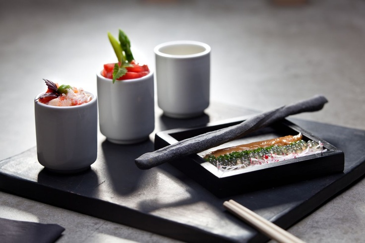 Kani Sambaizu  Traditional Japanese bento box with delicate brown crab, cherry tomatoes in Sambai Zu sauce with liquid smoke and Genmaicha, accompanied by tapioca pearls, chive and red radish with dark miso mayonnaise