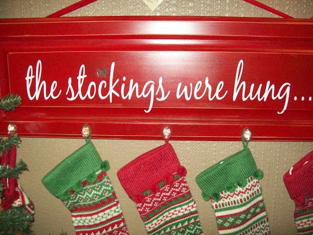 great way to hang the stockings if you don't have a fireplace... using old cabinet doors