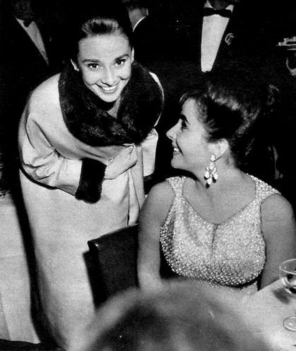 """Audrey Hepburn and Elizabeth Taylor at a dinner party followed by the premiere of """"Suddenly Last Summer"""" on December 22nd 1959."""