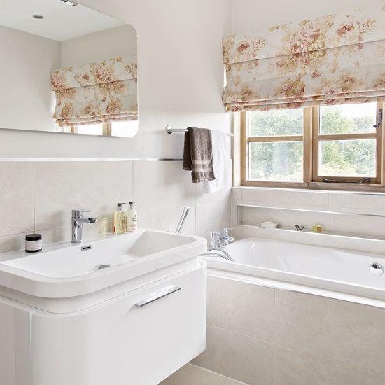 Pretty cream bathroom with floral Roman blind