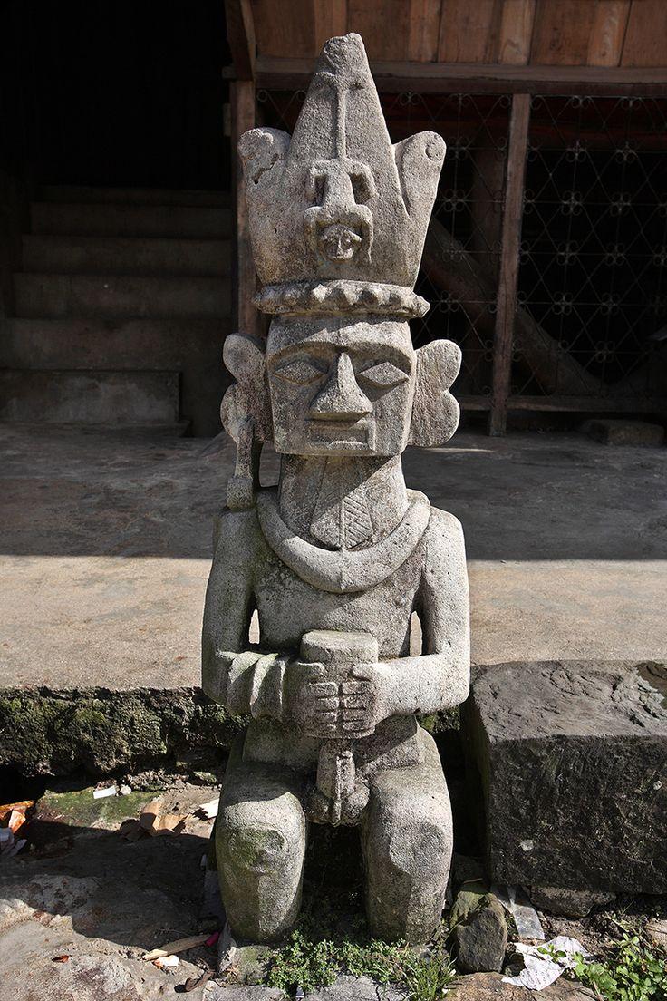 Stone statue in Bawömataluo village, south Nias. Nias Island, North Sumatra, Indonesia. Photo by Bjorn Svensson. www.visitniasisland.com