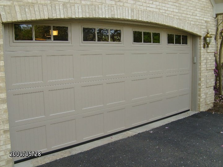 doors haas options the door grain design coated series available contemporary wood professional aluminum are on finishes from residential builder garage now powder