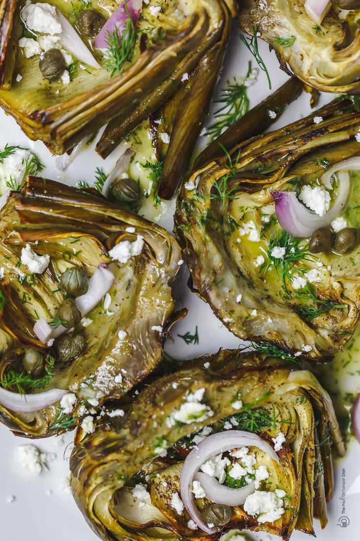 A simple, all-star recipe for perfectly tender roasted artichoke. With olive oil, tangy roasted garlic vinaigrette, capers and feta. The best!