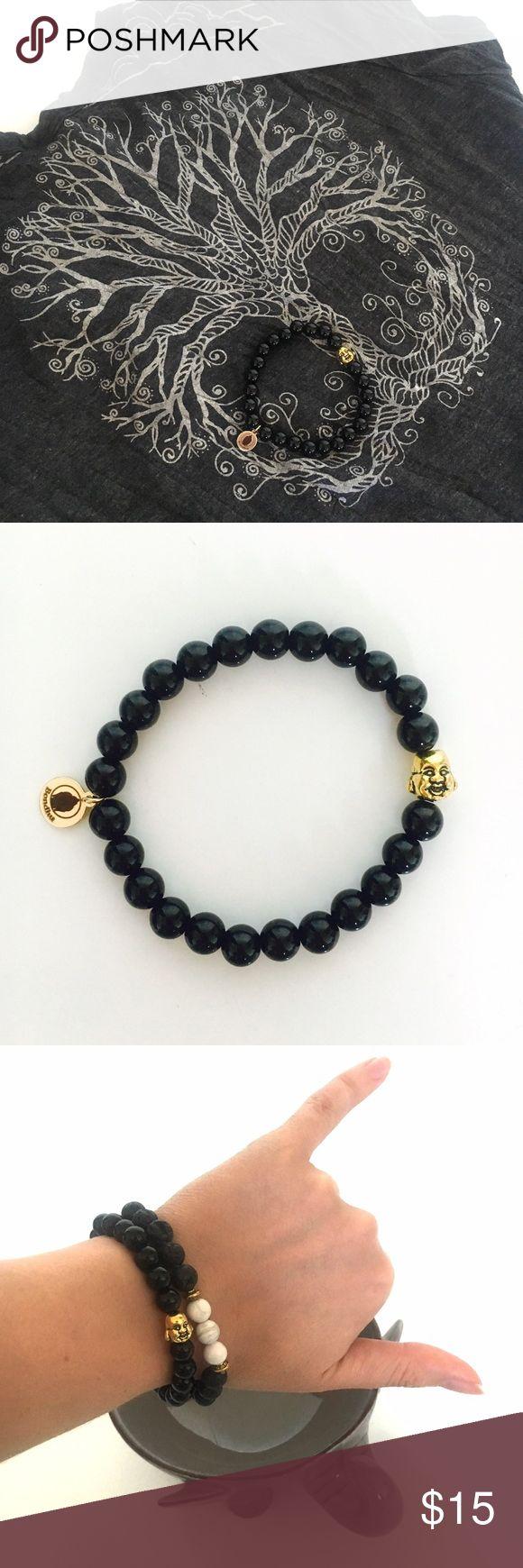 Buddha Black Tourmaline Mala Bracelet Black tourmaline mala bead bracelet with Buddha, gold plated tag, and stretchy band. Bondhu Jewelry Bracelets