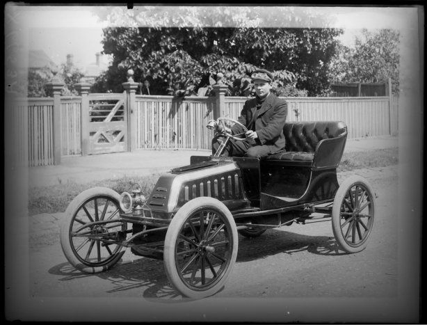 Charlie Mayman in the car he built himself, inclusive of engine. in St Kilda Road, Melbourne in 1903
