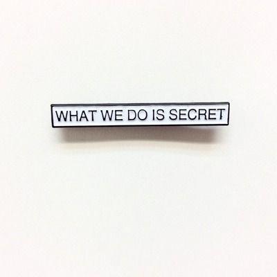 WHAT WE DO IS SECRET soft enamel pin