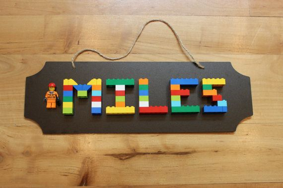 Perfect for a LEGO room or any kid's bedroom.  Made with real LEGO bricks and a mini figure next to child's name. Would also make a great birthday gift!