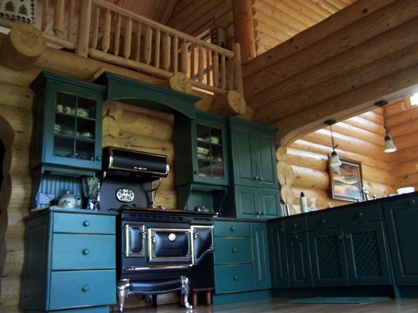 , Full log walls, custom knotty pine cabinets painted forest green