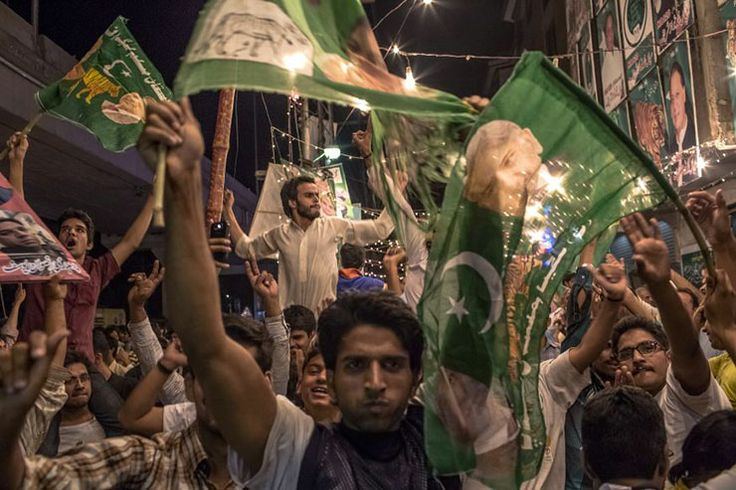 Credit: Daniel Berehulak/Getty Flag waving. Supporters of Pakistan Muslim League (N) celebrate election results in front of...