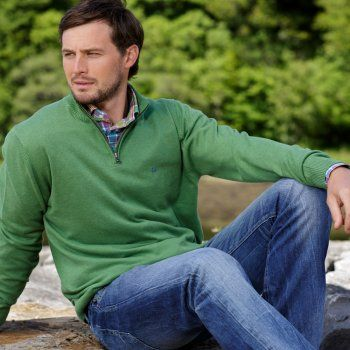 A grass green 1/4 zip cotton Magee jumper. We use melange yarns which give colour and textural interest. Features include - contrasting inside neck panel and our wolfhound logo.