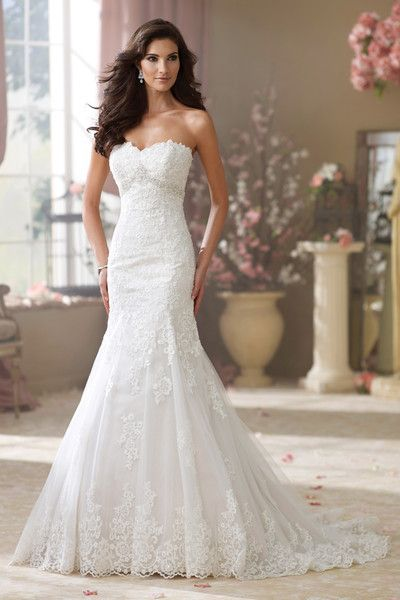 A studding wedding dress with hand-beaded accents and a jewel beaded inverted empire waistband! #weddingdress #weddinggown {@David Tutera for Mon Cheri}