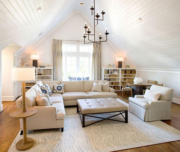 salle de séjour blanc et très élégant, canapé d'angle, fauteuil moderne, plafonnier noir, plafond en pente