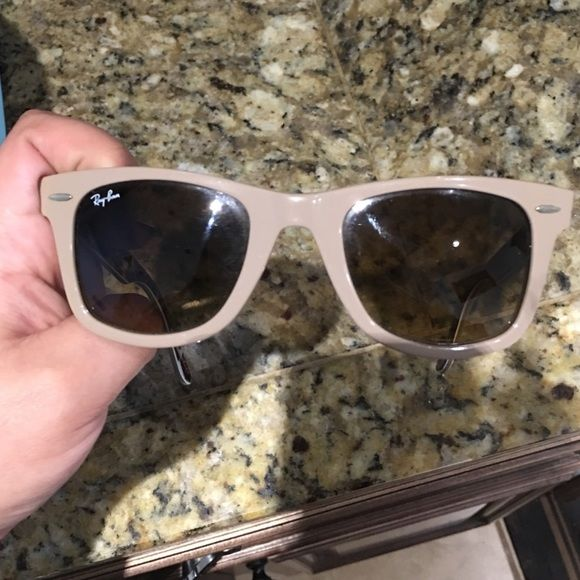 Ray Bans Wayfarer light tan sunglasses. Used Ray Bans Wayfarer sunglasses. Used. Light tan. Has guitars inside. Case not included. Open to offers! :) Ray-Ban Accessories Sunglasses
