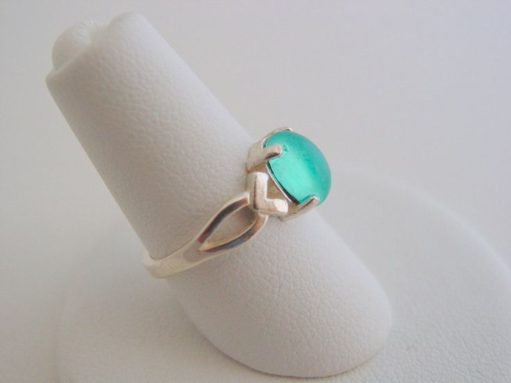 In Mako Mermaids, the girls wear Moon Pool rings and have to earn them, It also gives you land legs This ring would be perfect for your little mermaid for either show Sterling silver ring with a Swaro