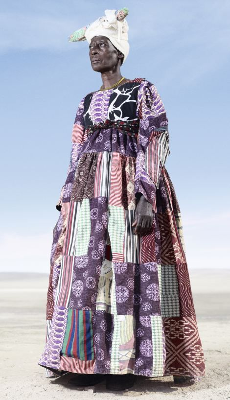 Herero woman in patchwork dress.: