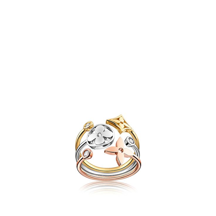 Stunning ring would complement any outfit or skintone  given the 3 golds. Louis Vuitton Monogram Idylle ring, 3 golds and diamonds.