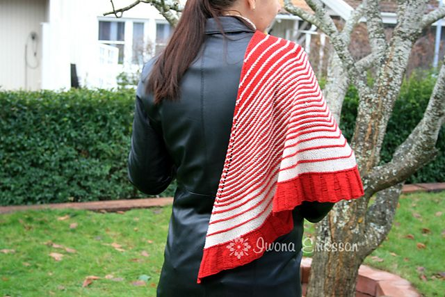 A lovely shawl worked from top down in stockinette and garter stitch with a ribbed ruffle on border. Worked with contrasting stripes in two colours.
