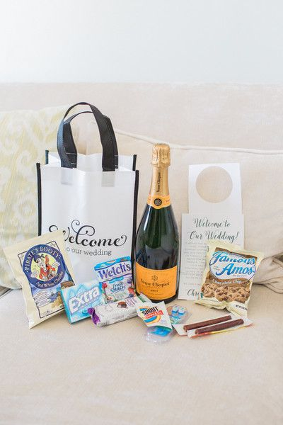 Wedding welcome bag idea - white + black welcome bag with champagne, snacks, gum and other goodies {Thompson Photography Group}