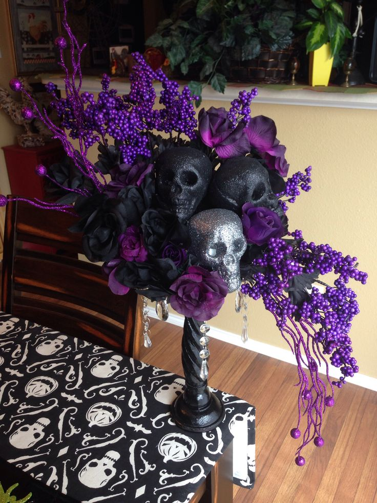 Halloween Skull Floral Centerpiece...now this Pretty I created using nothing but items from the Dollar Tree...everything except the wooden stand w chandelier crystals....was an old candlestick holder...I bought the round wood plate from WW, glued it on, sprayed gloss black..glued crystals wrapped w ribbon n BAM..a Gothic Chandelier Stand..!!! Just a Little Imagination...!