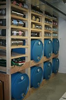 Awesome way to store water tanks.  Good use of vertical space since you normally can't stack the tanks on top of each other, and keeps the water tanks off the cement!  And with the hose bibs, the water tanks are all ready for use! :)