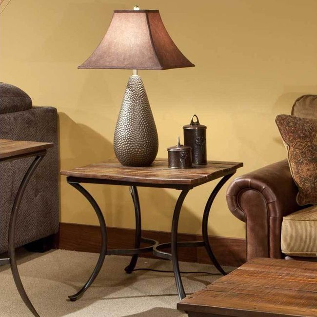 This beautiful accent table is fashioned from reclaimed-look wood and metal tube. With a mixed-media design, curved table legs, medium brown finish, and lightly distressed surfaces, this captivating table offers blend of rustic and industrial elements.Overstock.