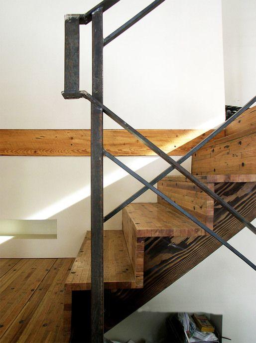Wood treads and risers. Steel railing.