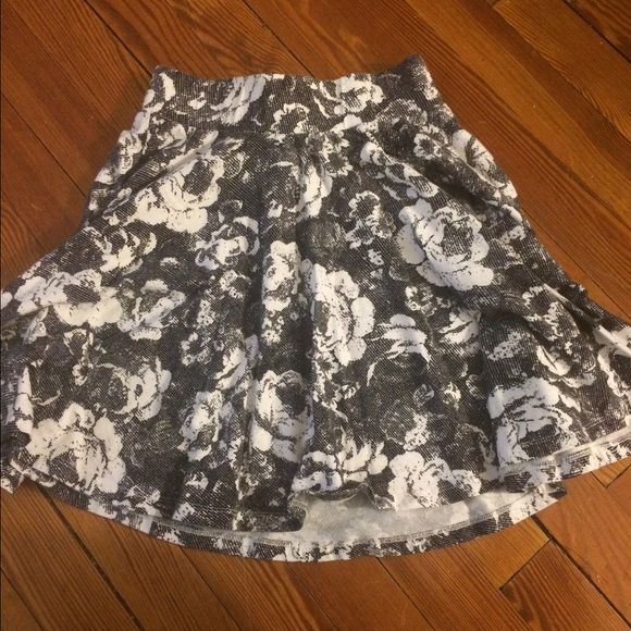Black and White floral skater skirt Super cute skater skirt by Pins and Needles from Urban Outfitters. Looks cute with crop tops or tight tops tucked in. I usually pair it with over the knee socks and combat boots. Great condition! Pins & Needles Skirts Circle & Skater
