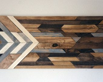 This piece is made to order. Lead time for shipping is 4 to 5 weeks. .  The photo shown is a previously sold beautiful modern art piece made with reclaimed wood. We have finished each piece of wood by hand then used 4 different shades of stain. These natural colors keep the rustic look of the wood by bringing out the grain while also giving it a modern touch by the way the pieces are placed together. This would look great hanging vertically in a bedroom, above a couch in a living room or…