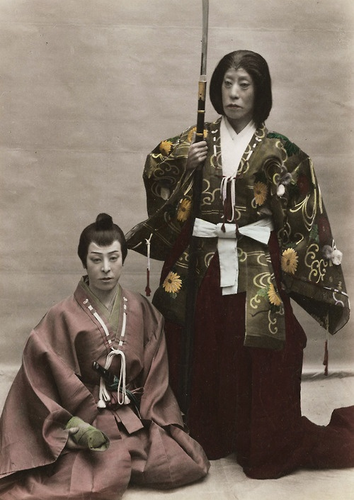 Hand-colored photo of Kabuki actors Danjuro and Fukusuke.  Circa 1890, Japan.  Photographer Kozaburo Tamamura. Fukusuke is dressed as a female warrior! (黒ネコ)