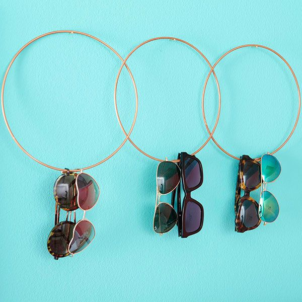 Best 25 sunglasses storage ideas on pinterest diy hat for Ways to hang hats on wall