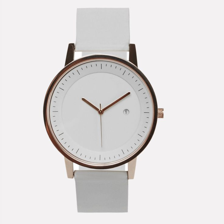 Simple Watch Company White & Gold Earl Watch: Simple Watch Company Earl Watch in white and gold. The perfect balance between style and functionality. Constructed with premium Japanese movements, scratch resistant glass and backed by a two-year guarantee. Contemporary design meets a classic colour palette with the Earl.
