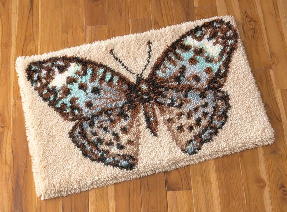 This butterfly latch hook rug will make a great floor mat especially during the spring and summer.