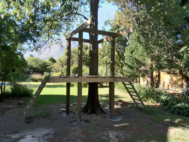 Treehouse Installation Day 3: First floor decking installed and support beams for tree house's second story in place.