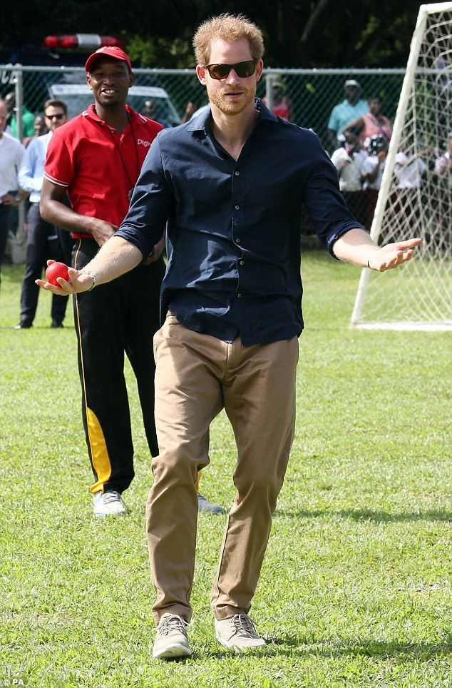 Harry later joined locals for a spot of cricket at a community sports event at Queens Park...