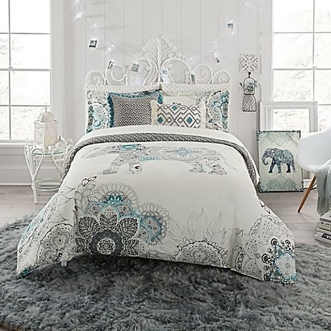 transform your bedroom into a soothing oasis with this anthology kiran comforter set offering a beautiful floral and elephant print in grey and teal on