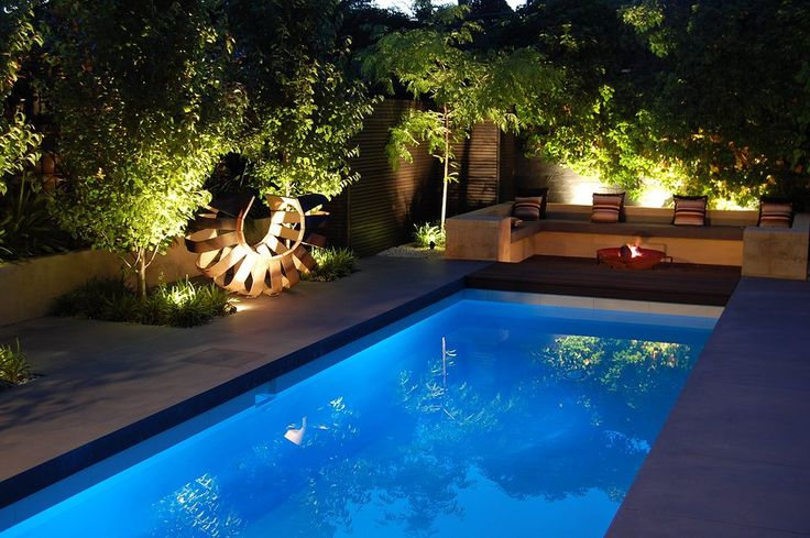 pool with seating area and fire pit Swimming