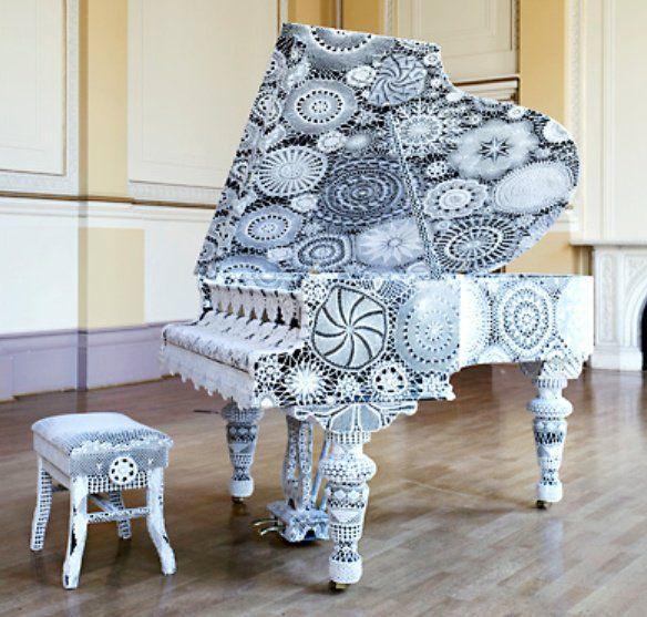 Piano. There is no link to this picture. It looks like doilies and lace.
