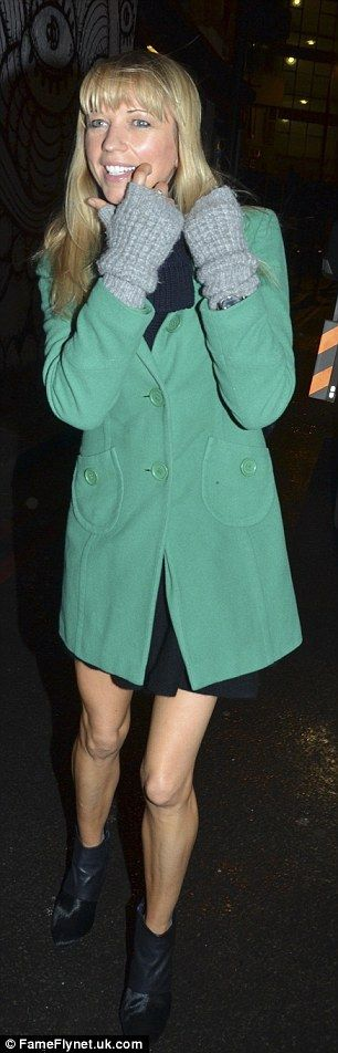 Green goddess: DJ Sara Cox stood out from the crowd in an emerald coat and bare legs...