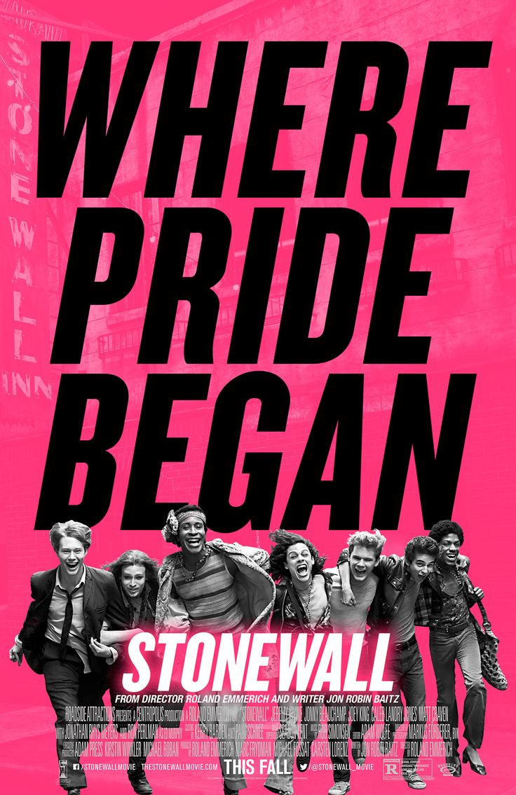 """A new poster for Roland Emmerich's LGBT rights drama Stonewall has arrived in a blaze of hot pink.  Bearing the tagline """"Where pride began,"""" the image shows several cast members — including Jeremy Irvine, Jonny Beauchamp, Otoja Abit, and Vladimir Alexis — joyously marching arm in arm."""